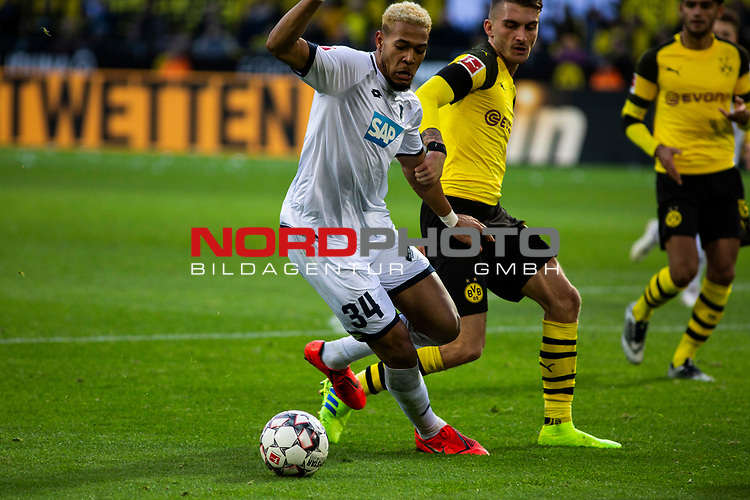 09.02.2019, Signal Iduna Park, Dortmund, GER, 1.FBL, Borussia Dortmund vs TSG 1899 Hoffenheim, DFL REGULATIONS PROHIBIT ANY USE OF PHOTOGRAPHS AS IMAGE SEQUENCES AND/OR QUASI-VIDEO<br /> <br /> im Bild | picture shows:<br /> Joelinton (Hoffenheim #34) im Duell mit Maximilian Philipp (Borussia Dortmund #20),  <br /> <br /> Foto © nordphoto / Rauch
