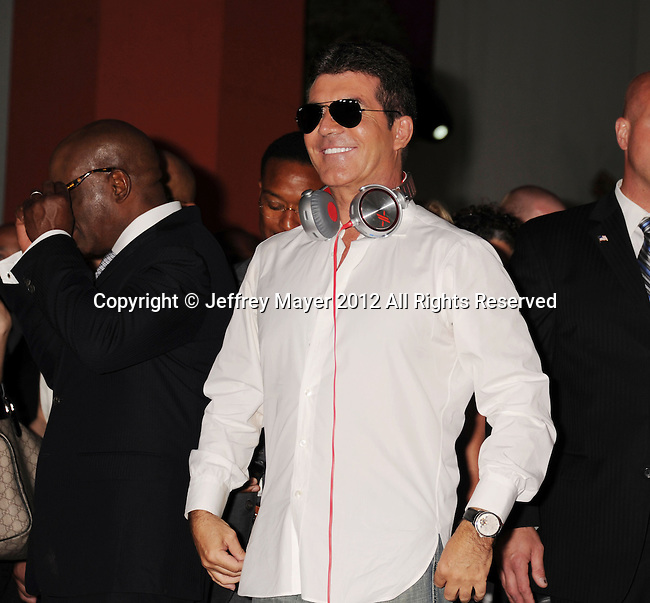 HOLLYWOOD, CA - SEPTEMBER 11: L.A. Reid and Simon Cowell arrive at the 'The X Factor' Season 2 Premiere Party at Grauman's Chinese Theatre on September 11, 2012 in Hollywood, California.