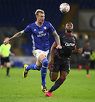 4th February 2020; Cardiff City Stadium, Cardiff, Glamorgan, Wales; English FA Cup Football, Cardiff City versus Reading; Aden Flint of Cardiff City heads the ball back to Neil Etheridge as Yakou Meite of Reading closes in from behind
