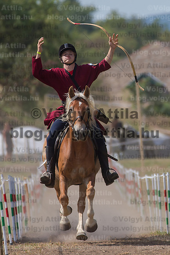 Participant reacts after missing a target during the European Open Championship of Horseback Archery in Veroce, about 60 km (37 miles) north of the capital Budapest, Hungary on August 31, 2012. ATTILA VOLGYI