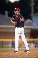 Batavia Muckdogs pitcher LJ Brewster (33) looks in for the sign during a game against the Mahoning Valley Scrappers on June 22, 2015 at Dwyer Stadium in Batavia, New York.  Mahoning Valley defeated Batavia 15-11.  (Mike Janes/Four Seam Images)