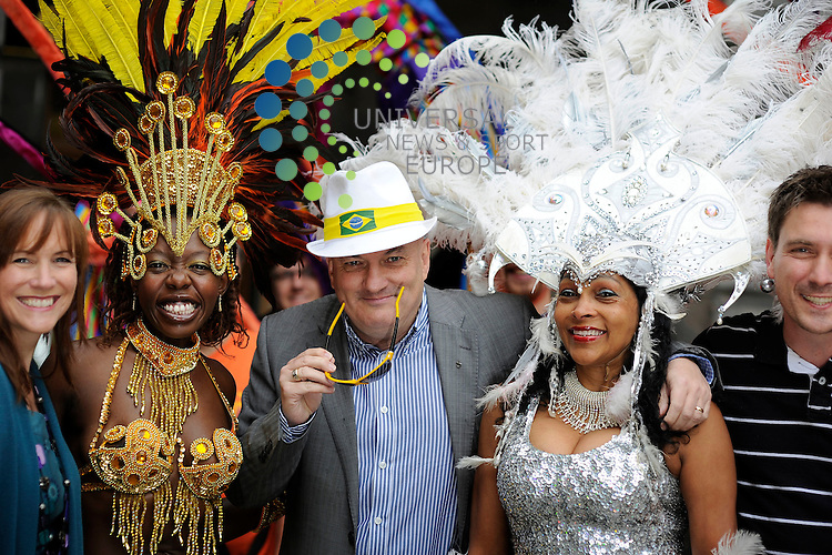 Councillor Steve Cardownie is joined by Arlene and Dingo from Forth one 'Boogie in the Morning' and performers from Edinburgh Samba School ahead of Sunday 22nd Edinburgh Festival Carnival, 10th July 2012 Pictured Performer in Gold Tichafara Chisaka, Red Pam Payne, Silver Lucia Falconer..Picture:Scott Taylor Universal News And Sport (Europe) .All pictures must be credited to www.universalnewsandsport.com. (Office)0844 884 51 22.