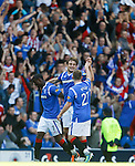 Nikica Jelavic on the pitch at the end as he celebrates with his team-mates and the bears