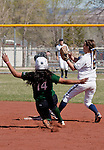 April 20, 2012:   University of Hawai'i Warrior #14 Alexandra Aguirre breaks up a double play as the Nevada Wolf Pack second baseman #8 Caylin Campbell gets the force out during their NCAA softball game played at Christina M. Hixson Softball Park on Friday in Reno, Nevada.