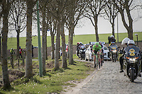 Sep Vanmarcke (BEL/Cannondale-Drapac) &amp; the other 2 race leaders choosing the gutter in the Paddestraat<br /> <br /> 72nd Omloop Het Nieuwsblad 2017