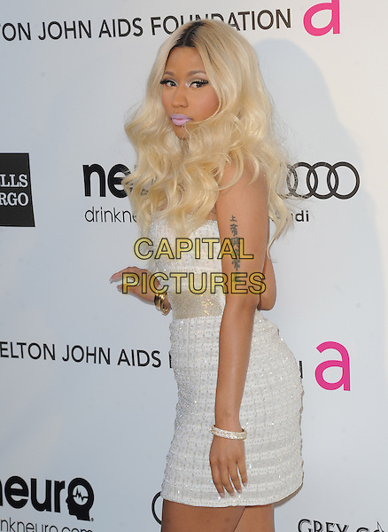 Nicki Minaj.The 21st Annual Elton John AIDS Foundation Academy Awards Viewing Party held at The City of West Hollywood Park in West Hollywood, California, USA..February 24th, 2013.oscars half length silver white strapless dress side tattoo cleavage .CAP/DVS.©DVS/Capital Pictures.