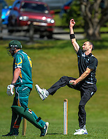 Andy McKay bowls during the Ewen Chatfield Trophy Wellington premier men's club cricket match between Karori and Naenae at Benburn Park, Karori, Wellington, New Zealand on Sunday, 31 October 2015. Photo: Dave Lintott / lintottphoto.co.nz