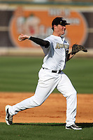 UCF Knights third baseman Nick Carrillo #30 throws to first during a game against the Siena Saints at the UCF Baseball Complex on March 3, 2012 in Orlando, Florida.  UCF defeated Siena 6-4.  (Mike Janes/Four Seam Images)
