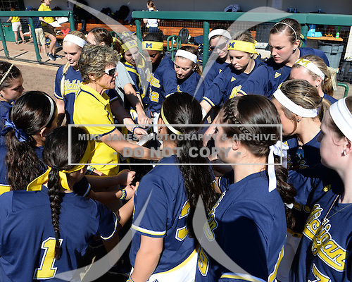 Michigan Wolverines Softball head coach Carol Hutchins talks with her team before a game against the Bethune-Cookman on February 9, 2014 at the USF Softball Stadium in Tampa, Florida.  Michigan defeated Bethune-Cookman 12-1.  (Copyright Mike Janes Photography)