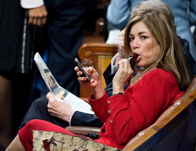 Rep. Loretta Sanchez, D-Calif., enjoys a lollipop as early arriving members of Congress wait for President Barack Obama to deliver his State of the Union Address on Jan. 27, 2010.
