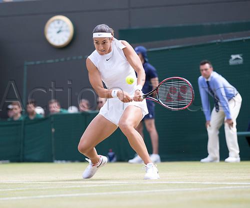 July 10th 2017, All England Lawn Tennis and Croquet Club, London, England; The Wimbledon Tennis Championships, Day 7; Caroline Garcia (FRA) hits a backhand return to Johanna Konta (GBR)