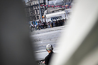 n this Tusday, Jun. 11, 2013 photo, a protester watchs over the anti-riot police from the distance during clashes at the streets of Taksim Square in Istanbul, Turkey. (Photo/Narciso Contreras).