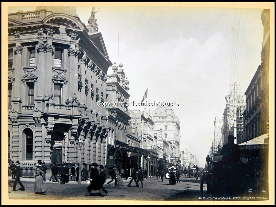 BNPS.co.uk (01202 558833)<br /> Pic: Nosbüsch&Stucke/BNPS<br /> <br /> The corner of Pitt Street and King Street in Sydney.<br /> <br /> A stunning collection of photographs of Sydney decades before the iconic harbour bridge and opera house were built has been unearthed after 129 years.<br /> <br /> The black and white photo album captures the bustling city centre, picturesque main harbour and famous beaches of the future tourist hot-spot. <br /> <br /> The photos were taken by celebrated Australian photographer Henry King in 1888 who was born in England but emigrated to Australia at a young age and spent the rest of his life there.<br /> <br /> More recently they have fallen into the hands of a German collector who has decided to put them on the market and they are tipped to sell for £1,800.<br /> <br /> Many of Sydney's most recognisable landmarks including Manly beach and Coogee bay look very different to what backpackers would encounter today.<br /> <br /> King also took various photos of Circular Quay - the city's main harbour - but missing from them are images of the Sydney Harbour Bridge and Sydney Opera House as these landmarks were both not built until well into the 20th century.