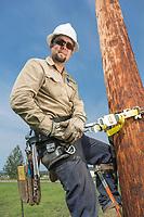 Doyon Utilities employee working on Fort Wainright, Fairbanks, Alaska
