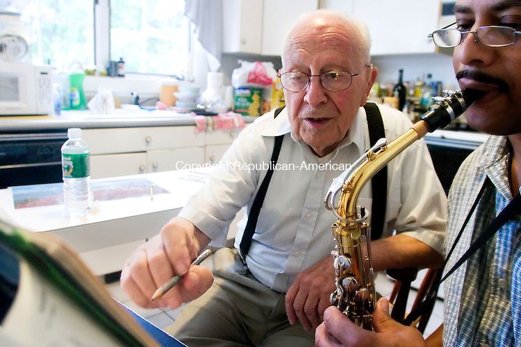 MIDDLEBURY, CT- 22 SEPT 2007- 092207JT05- <br /> Michael Trentalange, 93, gives Alton Taylor of Waterbury a saxophone lesson at Trentalange's Middlebury home on Saturday.<br /> Josalee Thrift / Republican-American