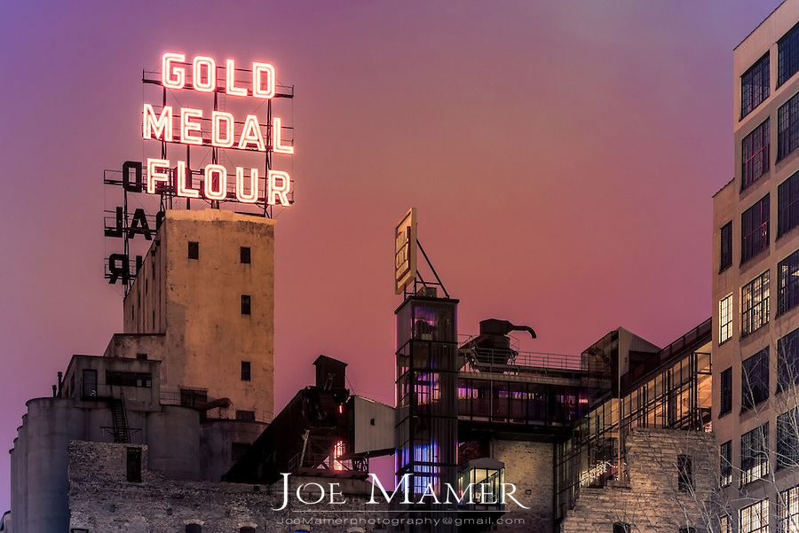 Gold medal Flower sign on the Mill City Museum at night  in downtown Minneapolis, Minnesota.
