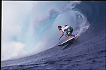 Teahupoo, Tahiti. May 2000. Ross WIlliams pig dogging the left at Teahupoo.