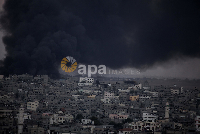 Smoke billows from a building hit by an Israeli air strike in Gaza City on July 25, 2014. Israel rejected a Gaza ceasefire proposal presented by US Secretary of State John Kerry, Israeli public television reported.. Photo by Ashraf Amra