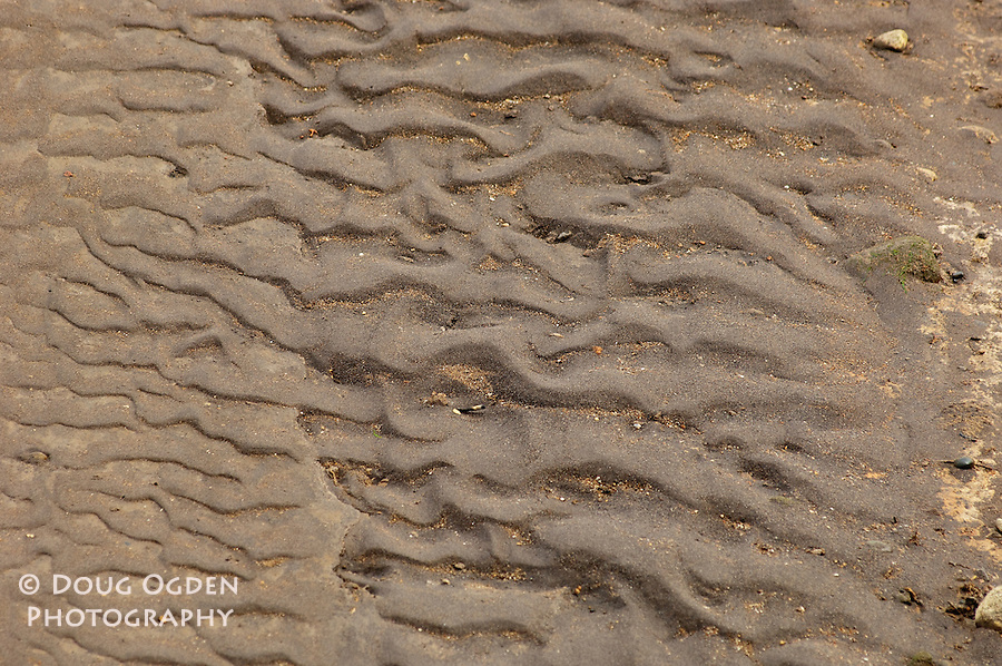 Texture in sand due to wind and water.