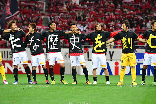 Urawa Reds team group,.MARCH 9, 2013 - Football / Soccer :.Urawa Reds players wear t-shirts with one letter each as they celebrate after the 2013 J.League Division 1 match between Urawa Red Diamonds 1-0 Nagoya Grampus Eight at Saitama Stadium 2002 in Saitama, Japan. (Photo by AFLO)