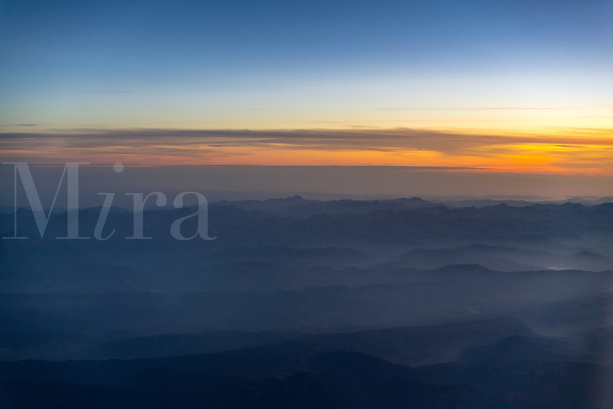 Mountain range aerial at dawn, Spain.