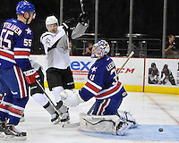 San Antonio Rampage right wing Joey Crabb (37) celebrates a Rampage goal between Rochester Americans goaltender Nathan Lieuwen, right, and Amerks defenseman Rasmus Ristolainen, in the second period of an AHL hockey game, Saturday, Jan. 18, 2014, in San Antonio (Darren Abate/AHL)