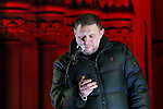 "© Joel Goodman - 07973 332324 .  03/02/2015 . Manchester , UK . Madchester star SHAUN RYDER reads a short speech from his phone to the crowd , at the demonstration . Demonstration organised by the Labour Party on the steps of Manchester City Council in Albert Sqaure , Manchester , under the banner ""manVcam"" ( Manchester vs Cameron ) . Organisers say Manchester - along with Liverpool and Birmingham - have suffered larger cuts than other regional authorities , whilst southern regions such as Surrey , Hampshire and West Sussex have all seen increases in government funding . Photo credit : Joel Goodman"