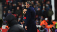 STOKE, ENGLAND - DECEMBER 2: Swansea City manager Paul Clement talks with Leon Britton of Swansea City during the Premier League match between Stoke City and Swansea City at the bet365 Stadium on December 2, 2017 in Stoke, England. (Photo by Athena Pictures/Getty Images)