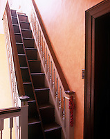 A steep flight of double steps leads up to the roof