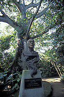 Bust of Mexican poet Carlos Pellicier and giant ceiba tree at the Parque Museo La Venta in Villahermosa, Tabasco. Mexico. Carlos Pellicer created this outdoor archaeology museum and ecological park in 1957.