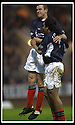 23/11/2002                   Copyright Pic : James Stewart.File Name : stewart-dundee v utd14.DAVID MCKAY CONGRATULATES CABALLERO AFTER HE SCORED THE SECOND......Payments to :-.James Stewart Photo Agency, 19 Carronlea Drive, Falkirk. FK2 8DN      Vat Reg No. 607 6932 25.Office     : +44 (0)1324 570906     .Mobile  : +44 (0)7721 416997.Fax         :  +44 (0)1324 570906.E-mail  :  jim@jspa.co.uk.If you require further information then contact Jim Stewart on any of the numbers above.........