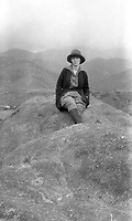 Woman seated on a boulder in Western United States,  circa 1930's.   (photo: www.bcpix.com)