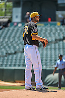 Salt Lake Bees starting pitcher Tyler DeLoach (32) looks to the catcher for the sign against the Albuquerque Isotopes in Pacific Coast League action at Smith's Ballpark on June 28, 2015 in Salt Lake City, Utah. The Isotopes defeated the Bees 8-3. (Stephen Smith/Four Seam Images)