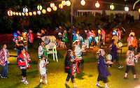 The community dances together at Hakalau Jodo Mission Bon Dance, Big Island of Hawai'i 2014, where local families come each year to celebrate their ancestors.
