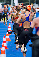 26 AUG 2012 - STOCKHOLM, SWE - The first competitors head for transition at the end of their swim at the 2012 ITU Mixed Relay Triathlon World Championships in Gamla Stan, Stockholm, Sweden .(PHOTO (C) 2012 NIGEL FARROW)