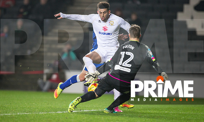 Daniel Powell of Milton Keynes Dons scores past Goalkeeper Ryan Fulton of Chesterfield 1 1 during the Sky Bet League 1 match between MK Dons and Chesterfield at stadium:mk, Milton Keynes, England on 22 November 2016. Photo by Andy Rowland.