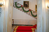 "The 2017 White House Christmas decorations, with the theme ""Time-Honored Traditions,"" which were personally selected by first lady Melania Trump, are previewed for the press in Washington, DC on Monday, November 27, 2017.  Pictured are the decorations on the Grand Staircase looking from the Grand Foyer.<br /> Credit: Ron Sachs / CNP"