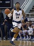 Nevada forward Jordan Caroline (24) brings the ball up the court against Utah State in the first half of an NCAA college basketball game in Reno, Nev., Wednesday, Jan. 2, 2019. (AP Photo/Tom R. Smedes)