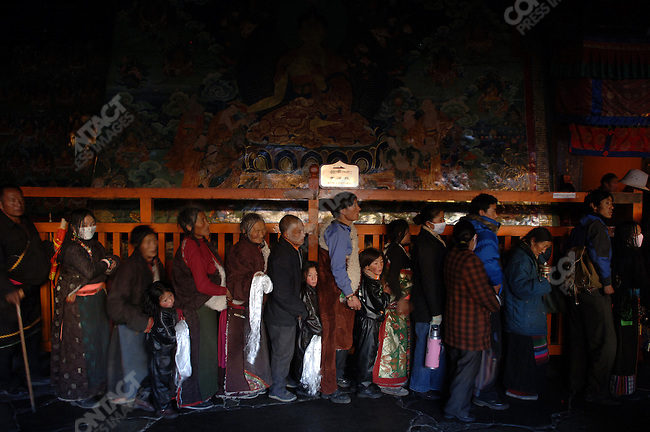 Tibetans waited in line to enter the Jokhang, the central cathedral of Tibetan Bhuddism, in Lhasa. November 14, 2006