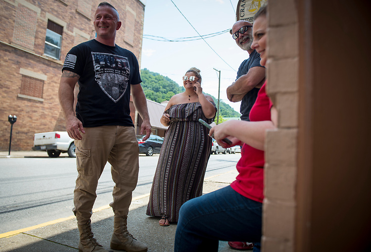 UNITED STATES - July 5: Richard Ojeda, left, stands outside his campaign headquarters in Logan, West Virginia alongside his communications director Madalin Sammons, 25, center, and campaign volunteer Heather Ritter, 39, Thursday July 5, 2018. Ojeda is a first-term lawmaker from southern West Virginia running to represent the state's 3rd Congressional District as a Democrat. (Photo By Sarah Silbiger/CQ Roll Call)