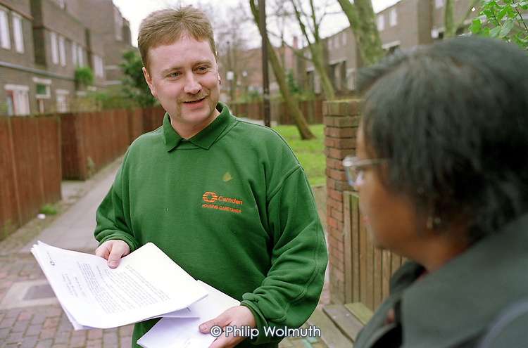 Caretaker talks with a resident on a Camden Council housing estate
