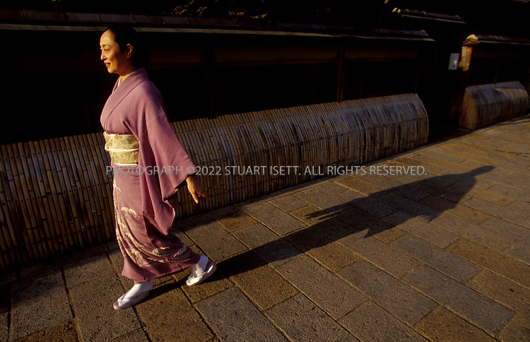 Kyoto, Japan..Mineko Iwasaki, once Kyoto's most famous geisha, wnaders teh streets of teh city's famous Gion District...All photographs ©2003 Stuart Isett.All rights reserved.
