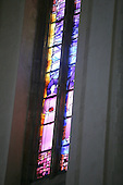 "Stained glass window. ""Service"" by artist, Mark Angus, in the Chancel of Guildford Cathedral."