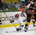 3 January 2009: Colgate Raiders' forward Austin Smith, a Freshman from Dallas, TX, is tripped against the Ferris State Bulldogs in the consolation game of the 2009 Catamount Cup Ice Hockey Tournament hosted by the University of Vermont at Gutterson Fieldhouse in Burlington, Vermont. The two teams battled to a 3-3 draw, with the Bulldogs winning a post-game shootout 2-1, thus placing them third in the tournament...Mandatory Photo Credit: Ed Wolfstein Photo