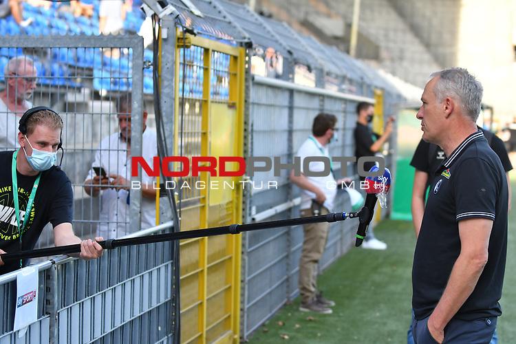 13.09.2020, Carl-Benz-Stadion, Mannheim, GER, DFB-Pokal, 1. Runde, SV Waldhof Mannheim vs. SC Freiburg, <br /> <br /> DFL REGULATIONS PROHIBIT ANY USE OF PHOTOGRAPHS AS IMAGE SEQUENCES AND/OR QUASI-VIDEO.<br /> <br /> im Bild: Christian Streich (Trainer, SC Freiburg), Interview mit Sicherheitsabstand<br /> <br /> Foto © nordphoto / Fabisch
