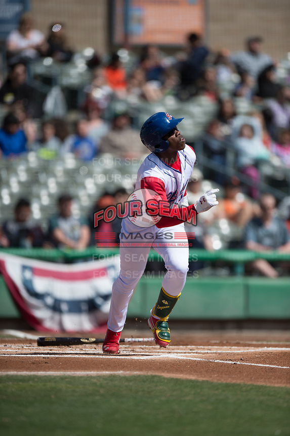 Stockton Ports left fielder Lazaro Armenteros (13) hits a home run during a California League game against the San Jose Giants on April 9, 2019 in Stockton, California. San Jose defeated Stockton 4-3. (Zachary Lucy/Four Seam Images)