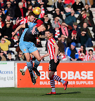 Lincoln City's Cian Bolger vies for possession with Stevenage's Alex Revell<br /> <br /> Photographer Chris Vaughan/CameraSport<br /> <br /> The EFL Sky Bet League Two - Lincoln City v Stevenage - Saturday 16th February 2019 - Sincil Bank - Lincoln<br /> <br /> World Copyright © 2019 CameraSport. All rights reserved. 43 Linden Ave. Countesthorpe. Leicester. England. LE8 5PG - Tel: +44 (0) 116 277 4147 - admin@camerasport.com - www.camerasport.com