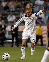 Los Angeles Galaxy midfielder (23) David Beckham takes a free kick during the first half against D.C. United at the Home Depot Center in Carson, CA on Wednesday, August 15, 2007. Beckham would score on the free kick and the Los Angeles Galaxy defeated D. C. United 2-0 in a SuperLiga semifinal match.