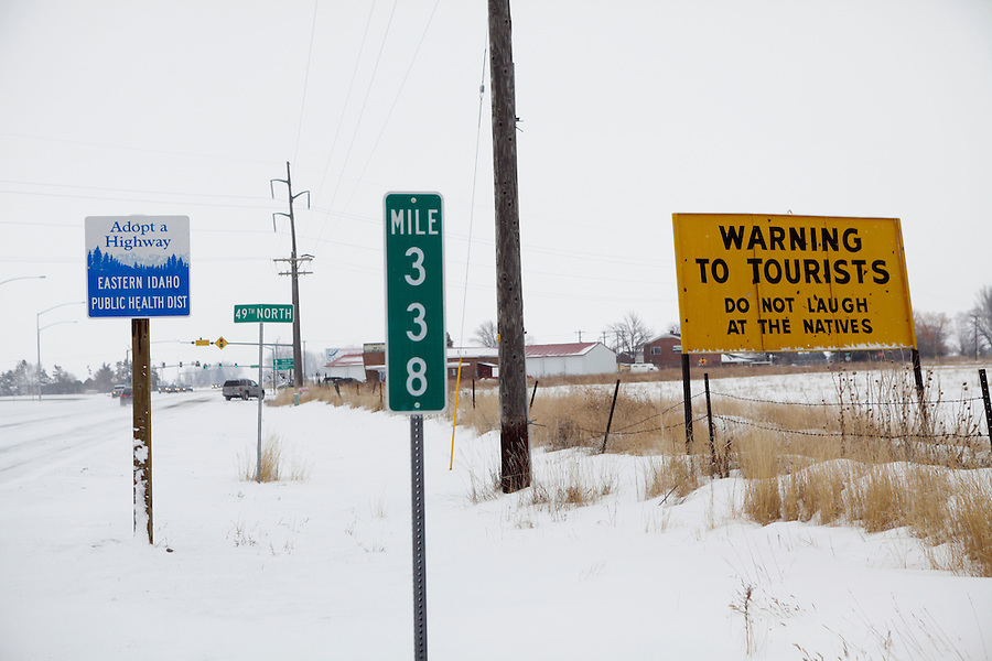 """A sign jokingly warns tourists """"not to laugh at the natives"""" on the outskirts of Idaho Falls."""