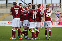 John-Joe O'Toole of Northampton Town (4th right) celebrates scoring his team's second goal against Morecambe to make it 2-0 during the Sky Bet League 2 match between Northampton Town and Morecambe at Sixfields Stadium, Northampton, England on 23 January 2016. Photo by David Horn / PRiME Media Images.